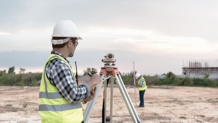 land surveyors working at construction site
