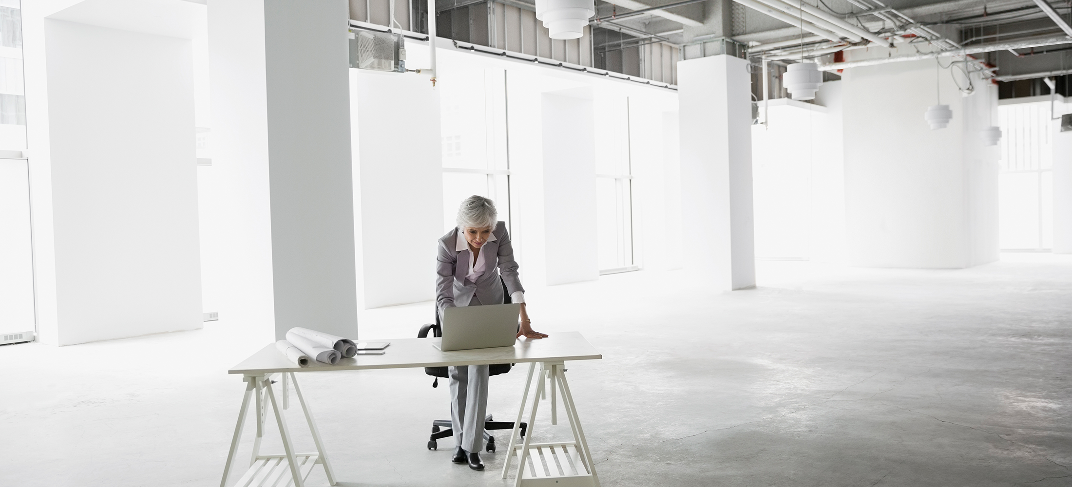 Architect working at laptop in empty office
